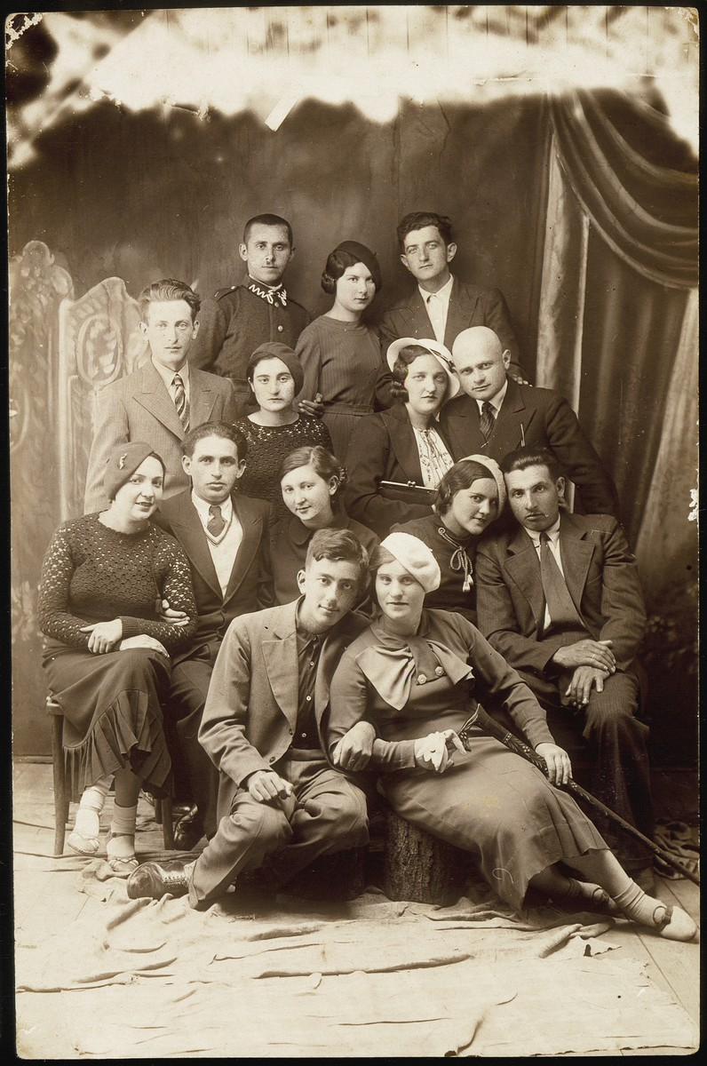 A group of young people in Eisiskes.    Back row from right to left: Shepske (Shabtai) Sonenson, Zlatke Kaganovicz, Zvi Hirshke Schwartz. Second row from top, right to left: Hayyim Bussel, his wife Golde Kabacznik Bussel, Rochel Mackewicz and Shepske (Shabtai) Kabacznik.  Third row from top, right to left: Motke Kaganowicz, Malka Nochomwicz, Esther (Etele) Katz Resnik, Shaul Berkowitch and Malka Matikanski. Sitting in front row, right to left: Hannah Krisilov and Dov (Berele) Wolotzki.  Shaul Berkowitch  and Malka Matikanski immigrated to Palestine.  Esther (Etele) Katz Resnik immigrated to Colombia, South America.  Dov (Berele) Wolotzki survived Dachau.  Shepske (Shabtai) Kabacznik survived the Holocaust in hiding.  Hayyim and Golde Bussel were murdered outside of Eisiskes with their children.  Rochel Mackewicz was murdered in an unknown location.  All the others were killed by the Germans during the September 1941 mass shooting action in Eisiskes.