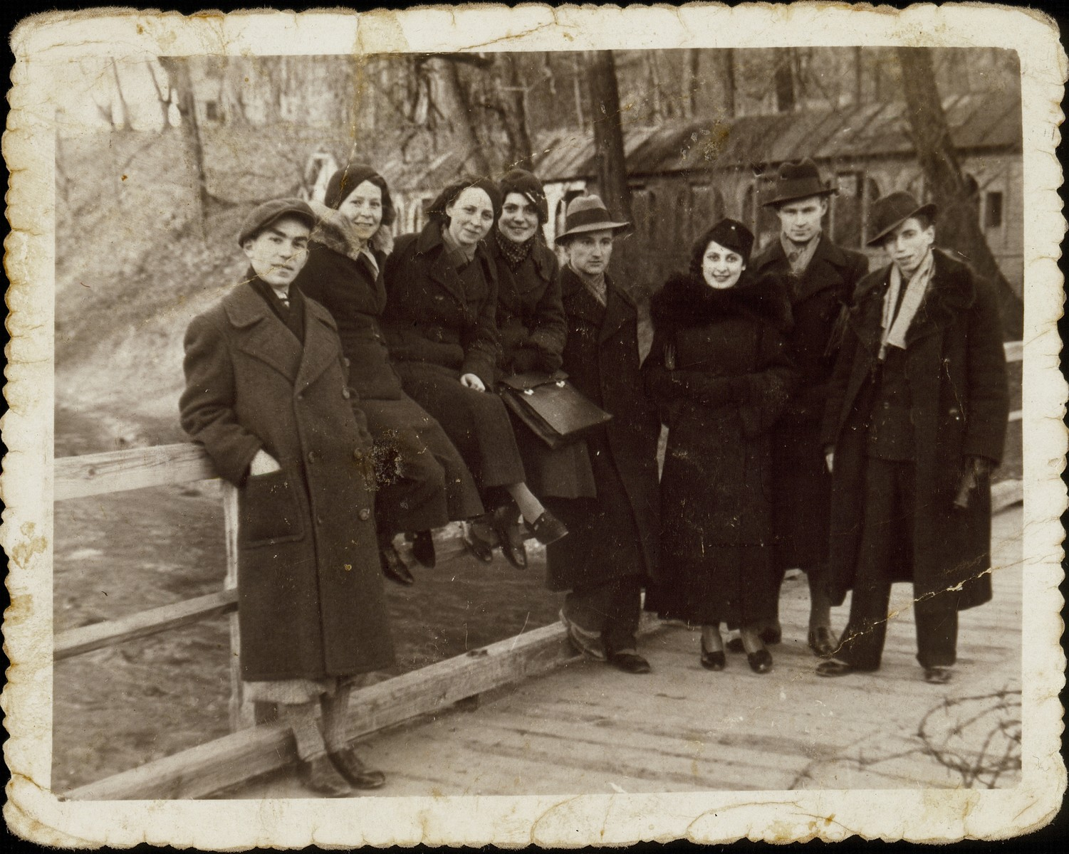 Chaim Paikowski (far left)  stands on a wooden bridge with a group of friends.