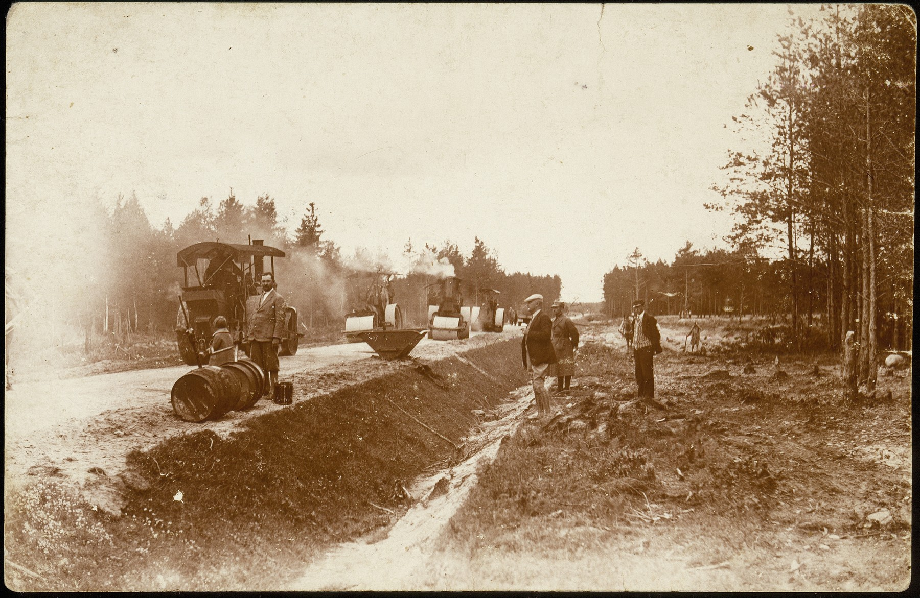 Workers pave the Pilsudski highway on the outskirts of Eisiskes.  A Polish worker inadvertenly ran over a his son, who was taking a lunchtime nap, with one of these large rollers.