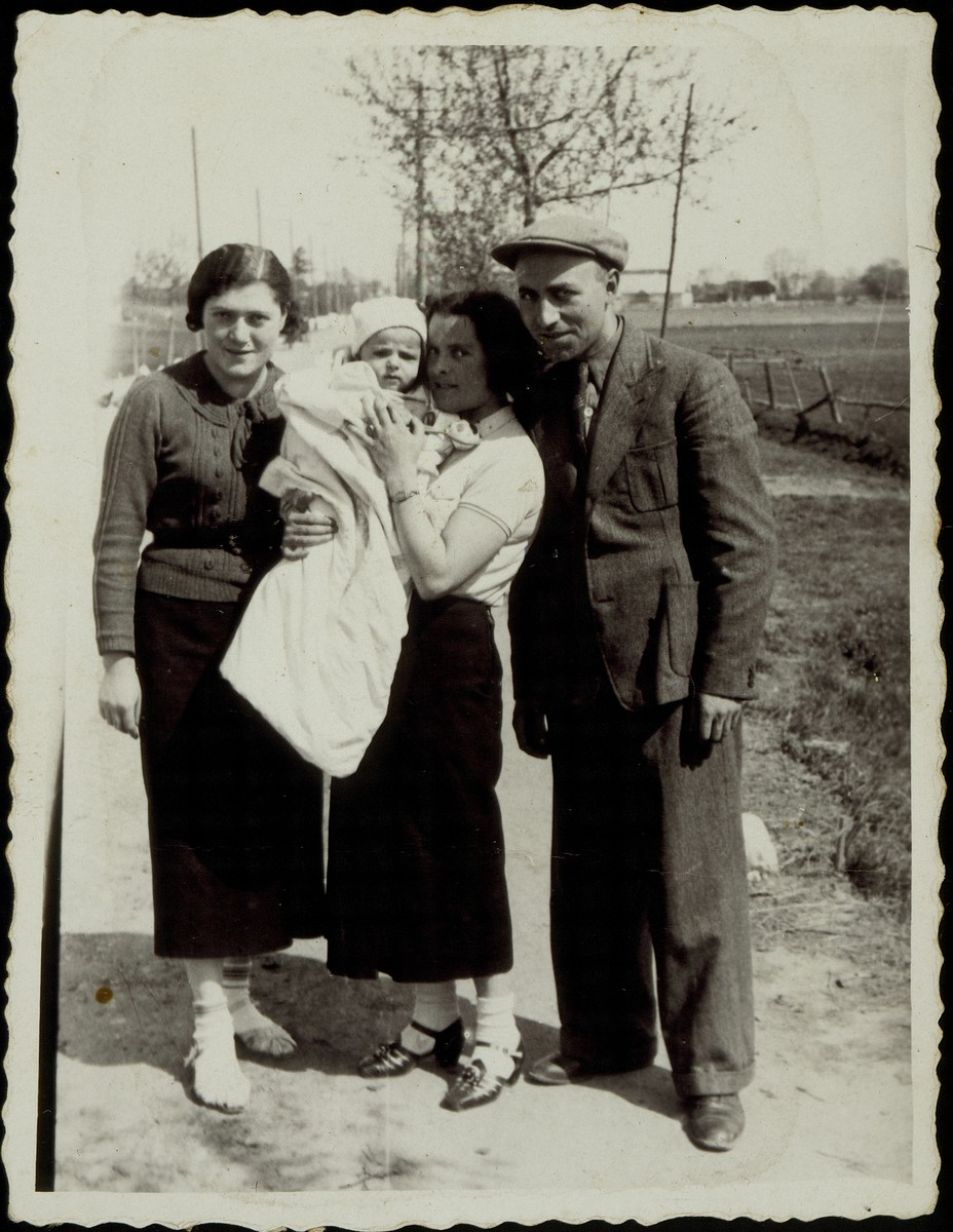 "Standing from right to left: Yehudah Gaikowski, his wife, Beila Portnoy Gaikowski holding their son Yitzhak'l and Hannah Dubczanski.   The photo is inscribed in Yiddish, ""For eternal memory for my beloved brother-in-law and sister-in-law from Yehudah, Beila, Yitzhak'l Gaikowski. 1938""  The Gaikowski family and Hannah Dubczanski were murdered by the Germans during the September 1941 mass killing action in Eisiskes."
