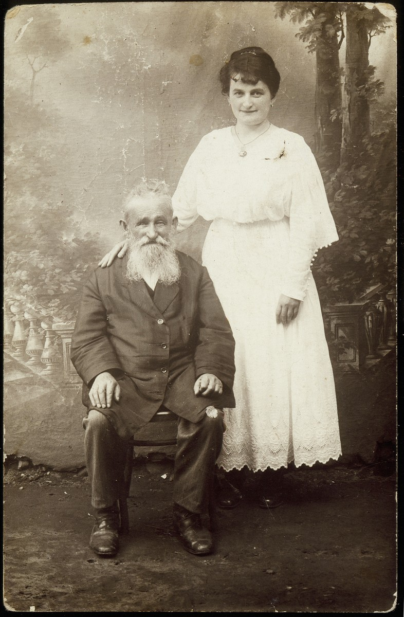 """Nehemia """"der Feldsher"""" Virshubski, the shtetl's folk doctor, poses with his daughter, Sonia.  Nehemia's favorite medical treatments were  cupping (bankes) and enemas.  At the end of World War I, he was shot by a Russian soldier.  Sonia Saposnikov often accompanied her father on his house calls.  She later became a prominent pharmacist in Vilna.  Sonia and her family disappeared during the Holocaust; they most probably were killed in Ponar."""