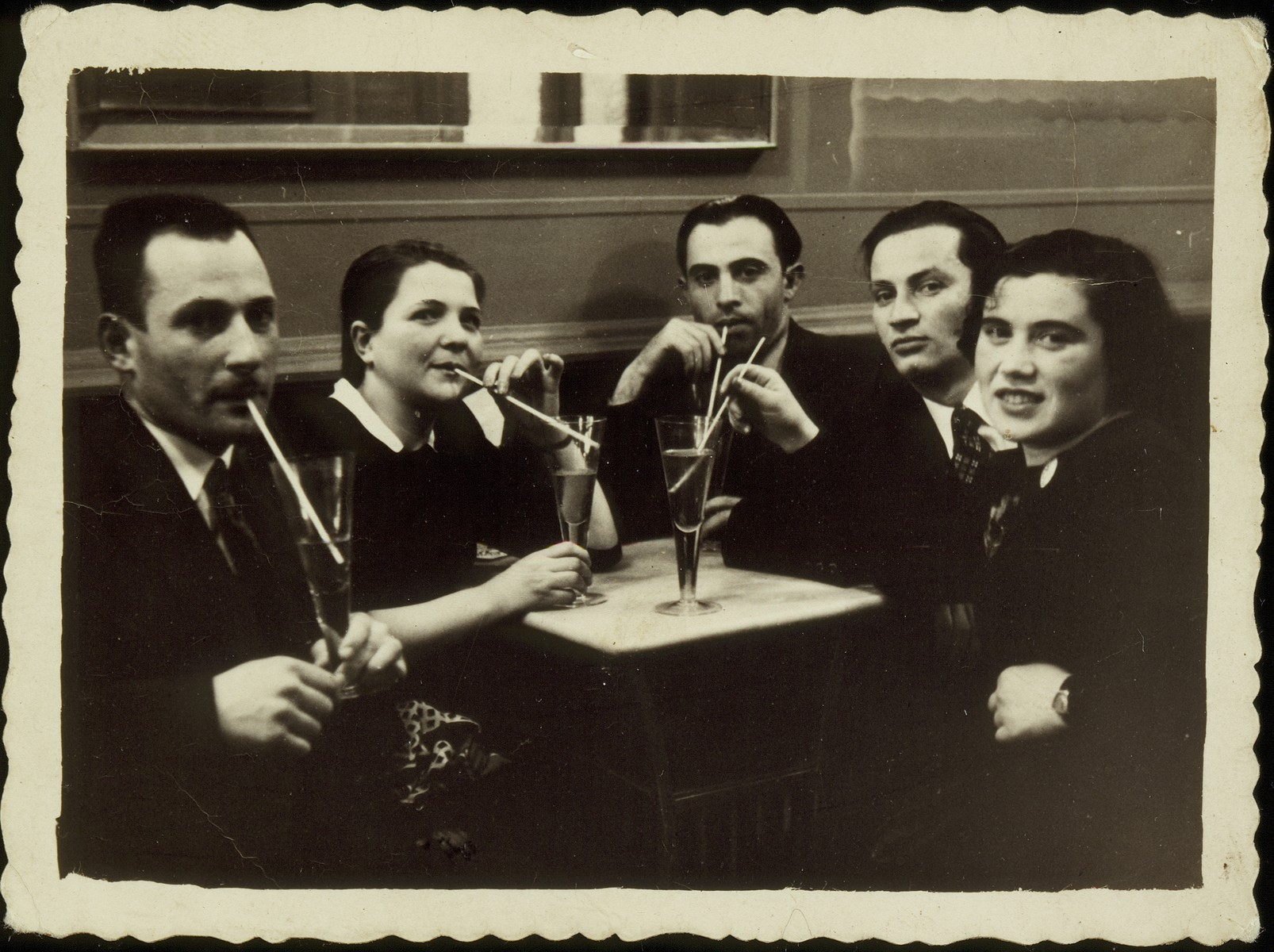 Etchke Jurdyczanski celebrates his plans to immigrate to Palestine in a restaurant in Vilna.   Etchke Jurdyczanski (Isaac Juris), is second from right.  He survived the Holocaust in Siberia, and the fate of the others is unknown.