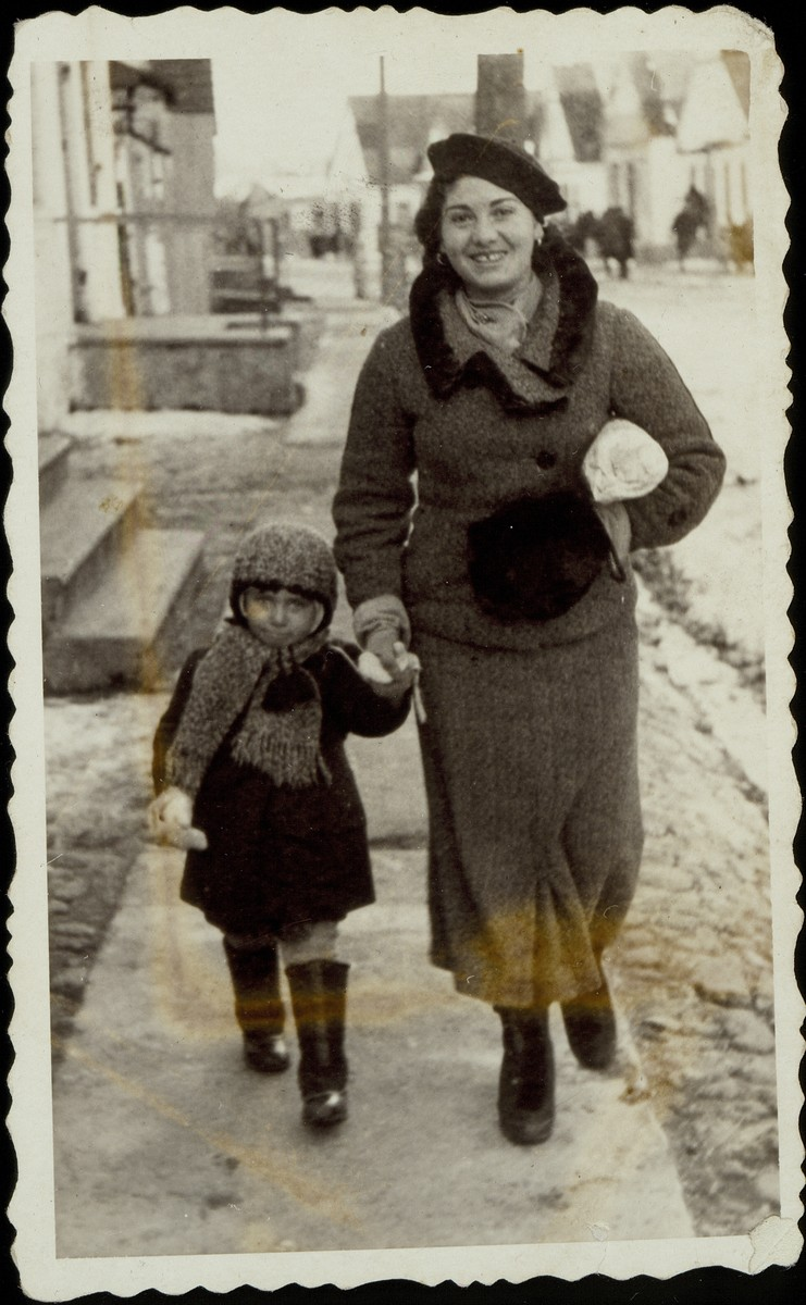 Bluma Jurdyczanski and her niece Leah'le Dugaczinski stroll down Vilna Street.    Leah'le and her parents were murdered by the Germans during the September 1941 mass killing action in Eisiskes.  Bluma survived the war in Russia.