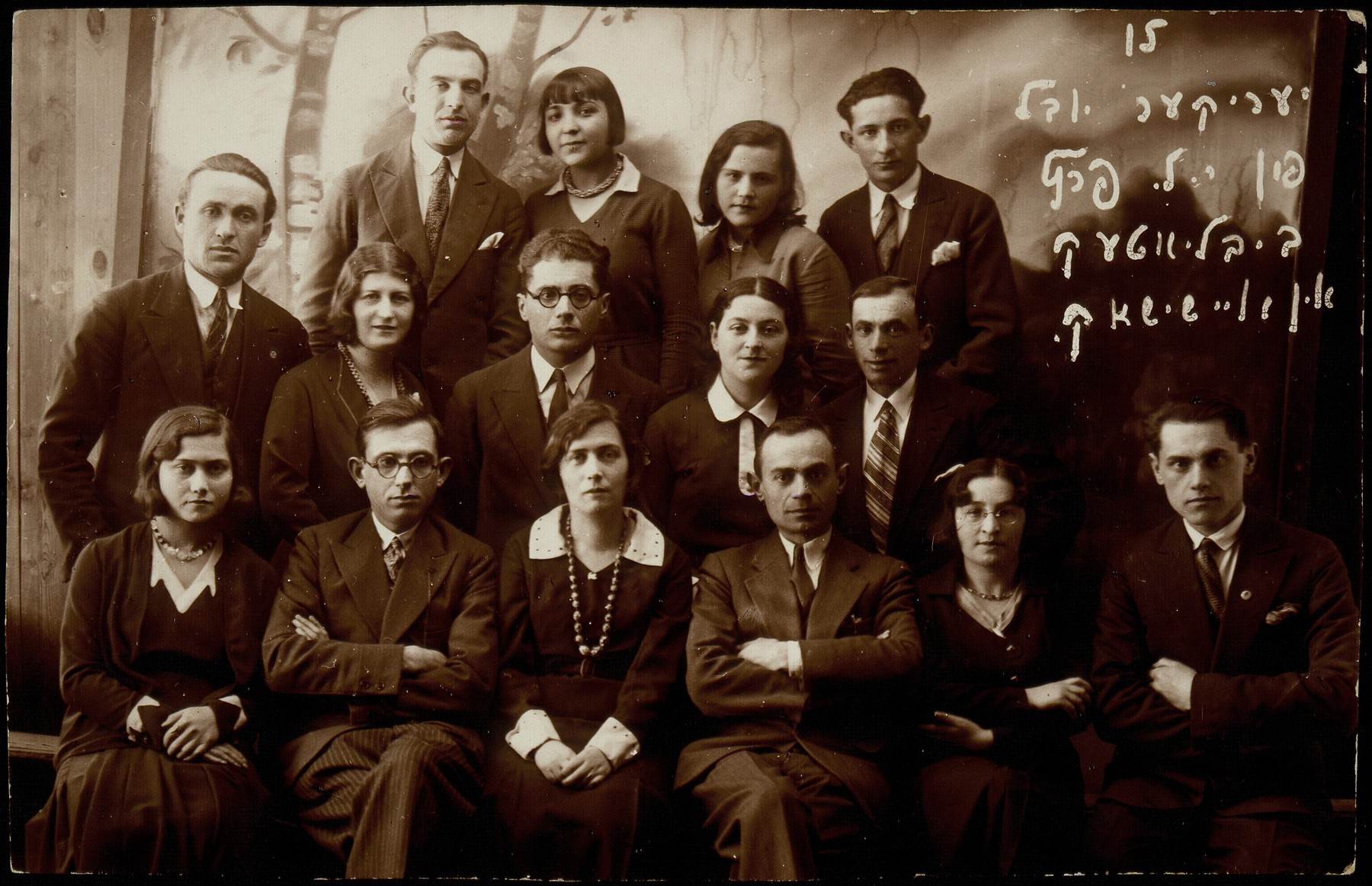 Commemoration of the 15th anniversary of the Y. L. Peretz library.    (first row, left) Batia Bastunski and Mordekhai (Motl) Replianski; Velvke Katz (fourth from left); (middle row, left) Velvke Kaganowicz;  Eli Politacki (third from left); Malka Matikanski (top row, second from left).   Batia immigrated to America; Malka went to Palestine.  Most of the other people pictured were murdered by the Germans during the September 1941 killing action in Eisiskes.