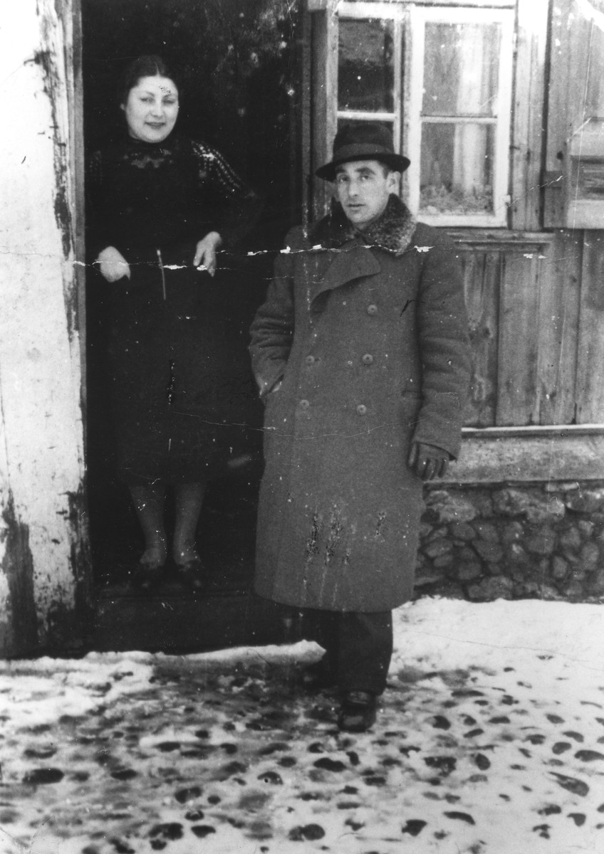 Members of the Shlachter family outside their home in Dabrowa Bialostocka.