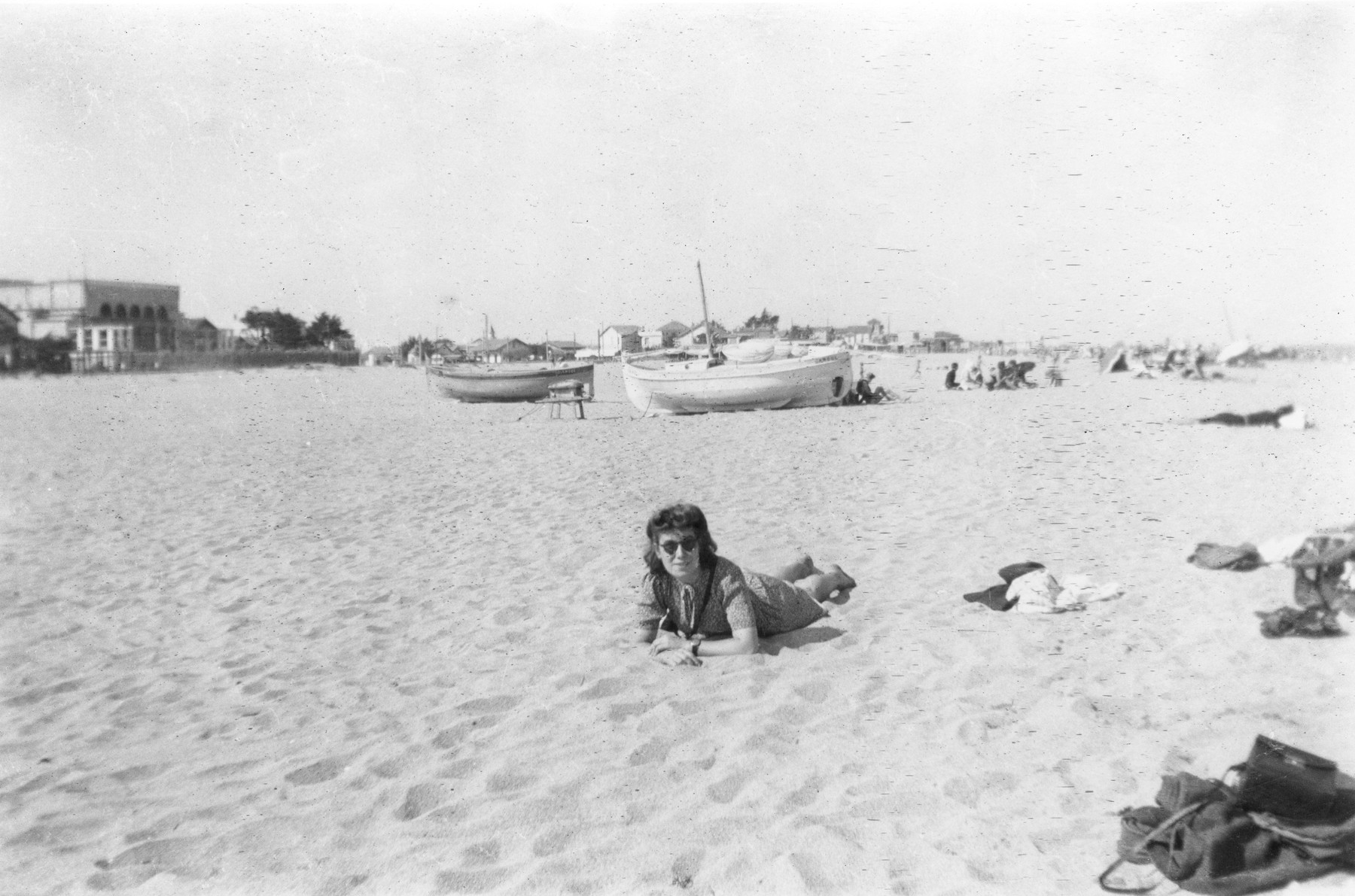 Solange Zitlenok rests on a beach.  A leader of OSE in southern France, Zitlenok found homes for Jewish children in hiding in southwest France.  She was later captured and shot.