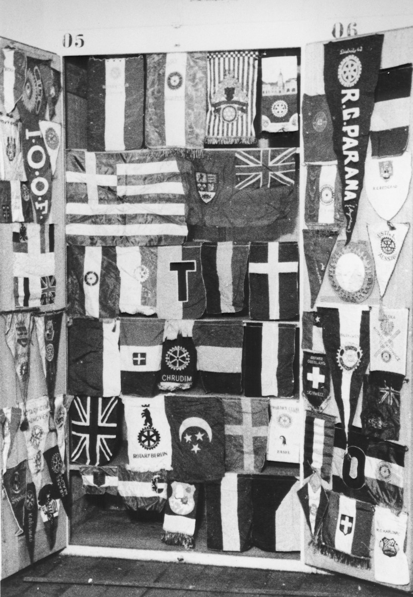Display of cloth banners from various organizations confiscated by the Nazis.