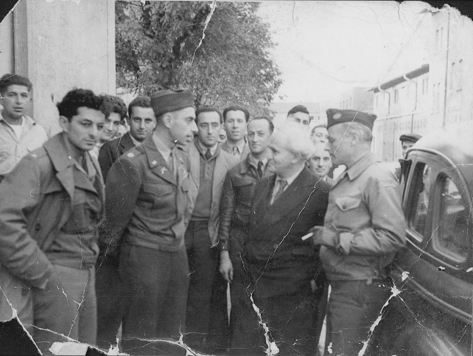 Major Irving Heymont converses with David Ben-Gurion during his visit to the Landsberg displaced persons camp.    Also pictured is U.S. Army chaplain, Rabbi Abraham Klausner (on the left ) and Abraham Glassgold, UNRRA camp director (at the far right).