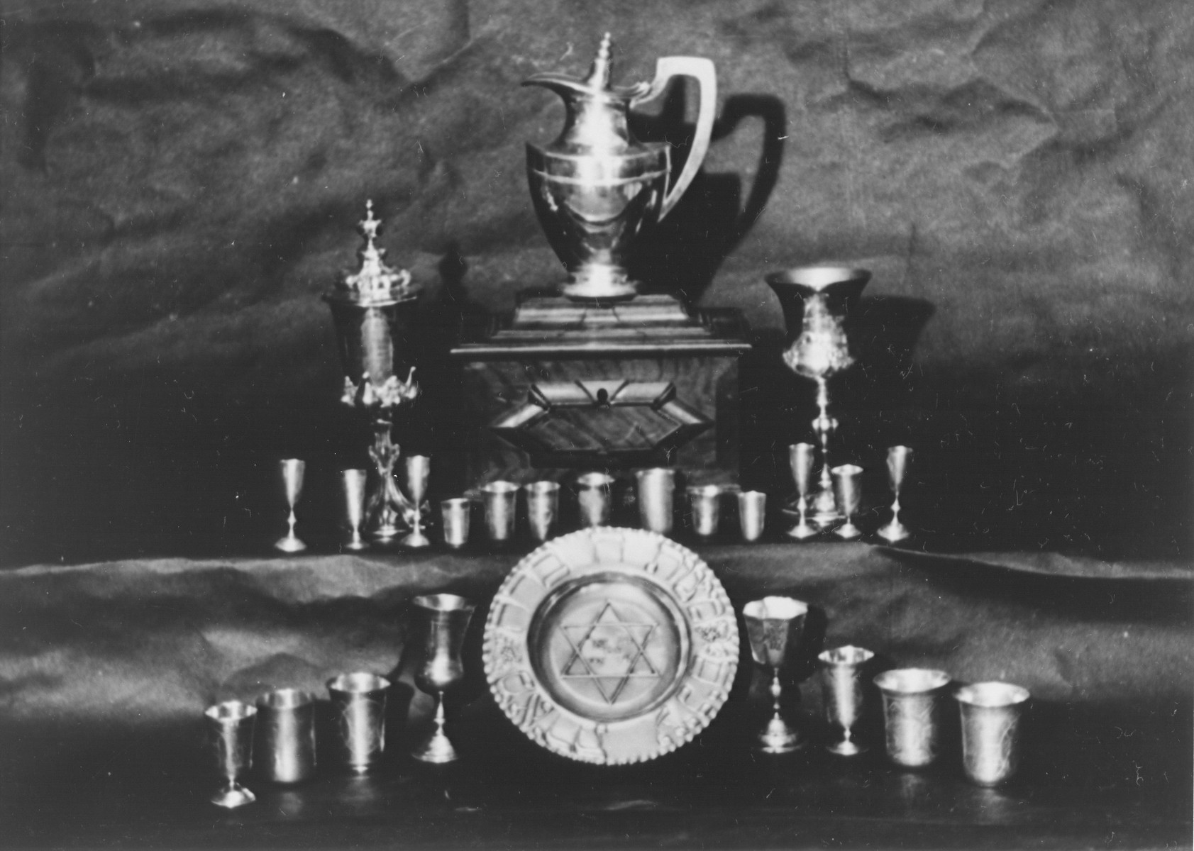 Display of confiscated silver kiddish cups and other Jewish religious articles.