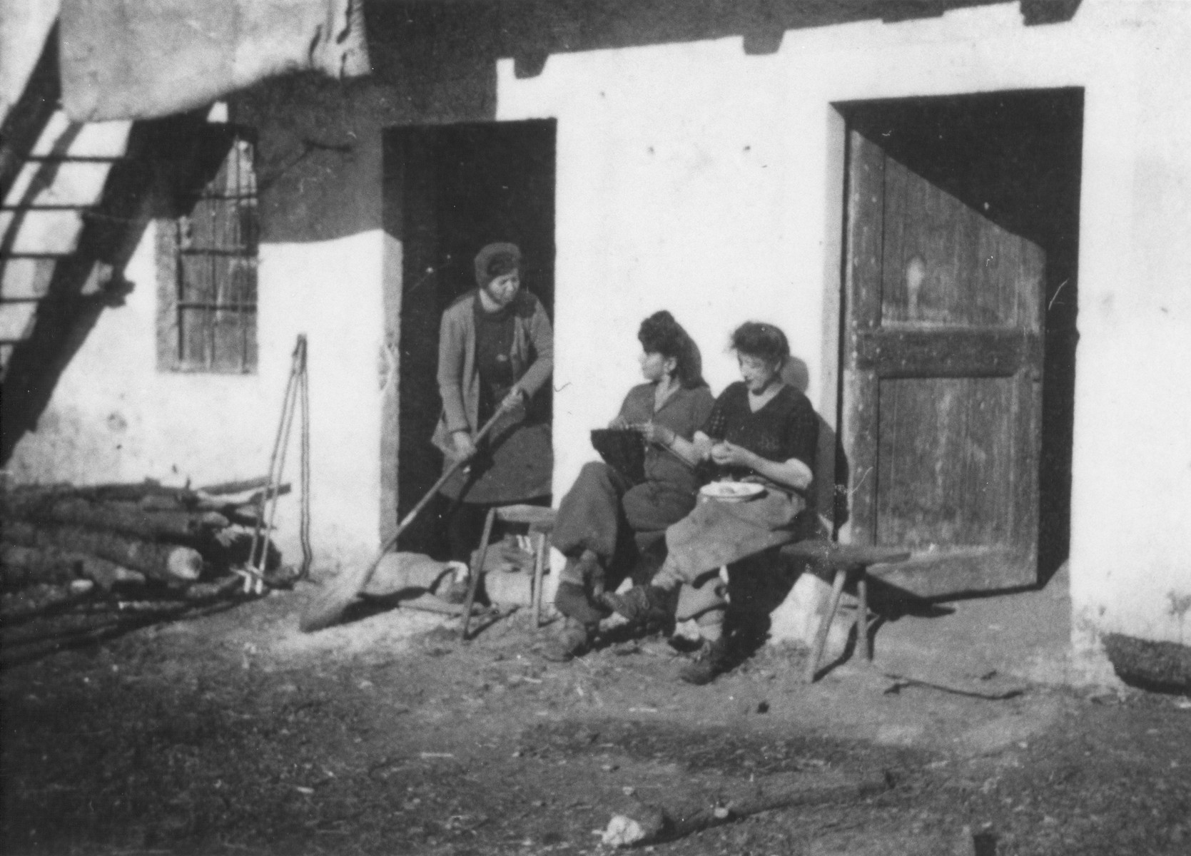 Jewish refugees perform daily tasks in a farm where they were hiding Valle Stura, Italy after crossing over the border from France.