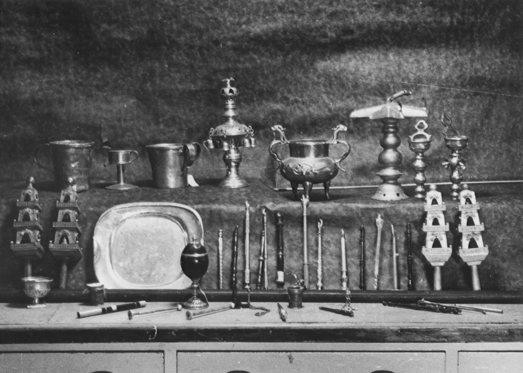 Display of confiscated silver torah crowns, torah pointers and other ritual objects looted from European synagogues.