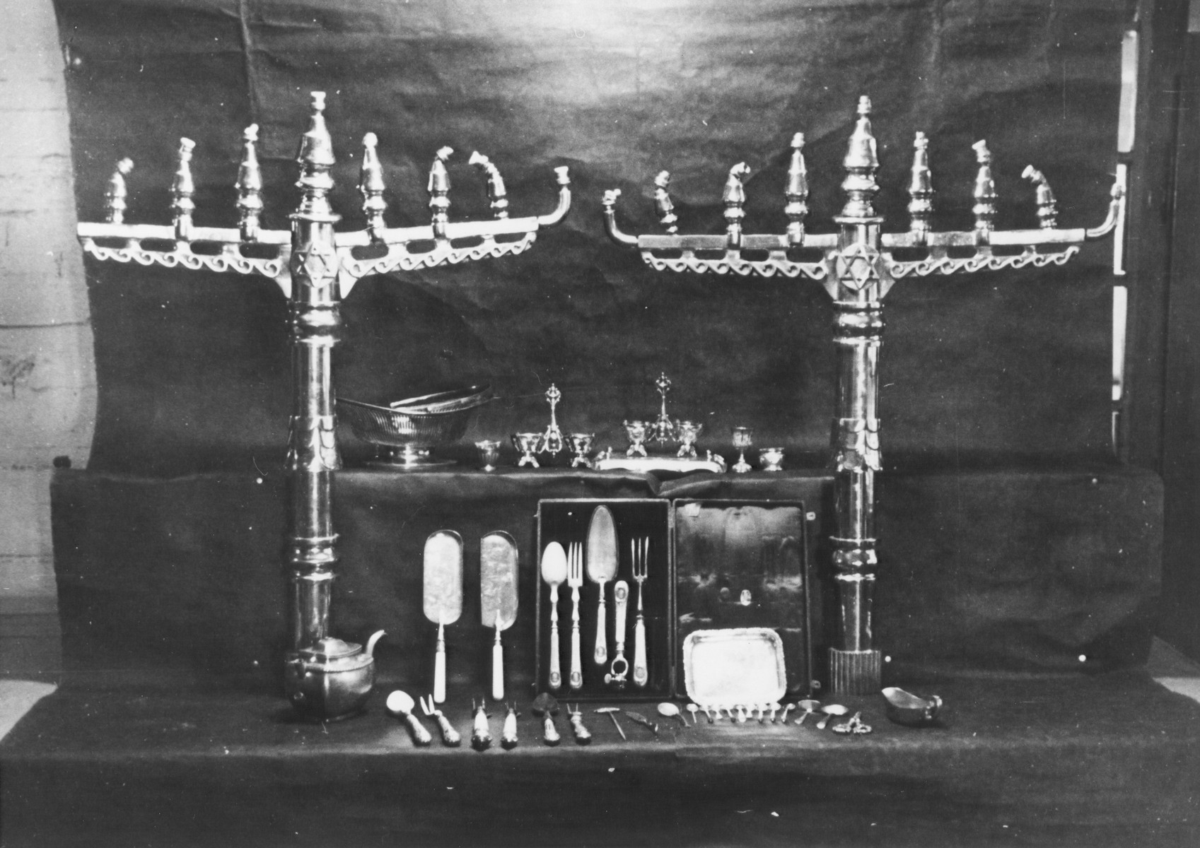 Display of confiscated menorahs and other ritual objects looted from European synagogues.