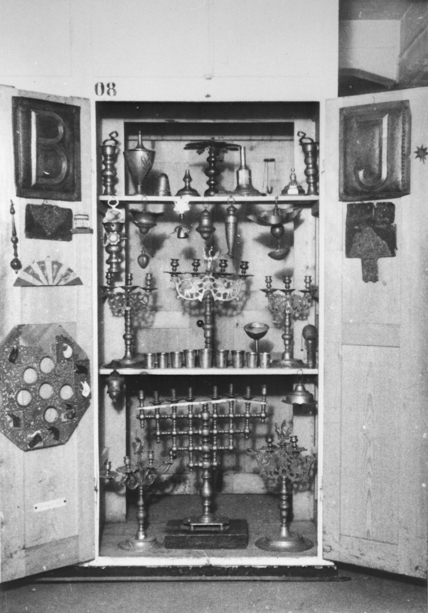 Display of Jewish silver ritual objects confiscated by the Nazis.