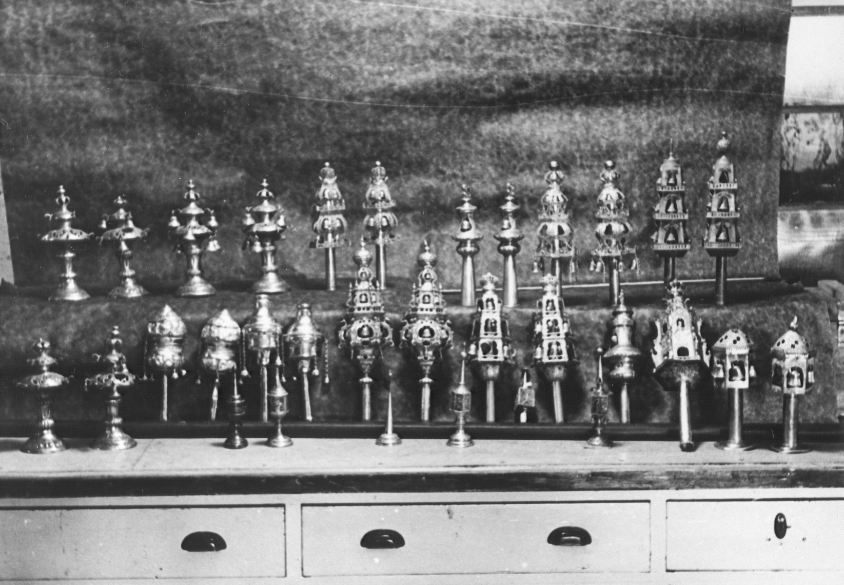Display of silver torah crowns confiscated by the Nazis.