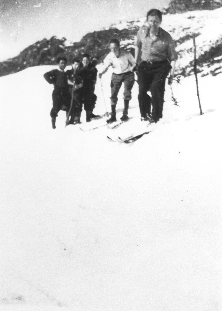 Jewish refugees ski near Valle Stura, Italy after crossing over the border from France.