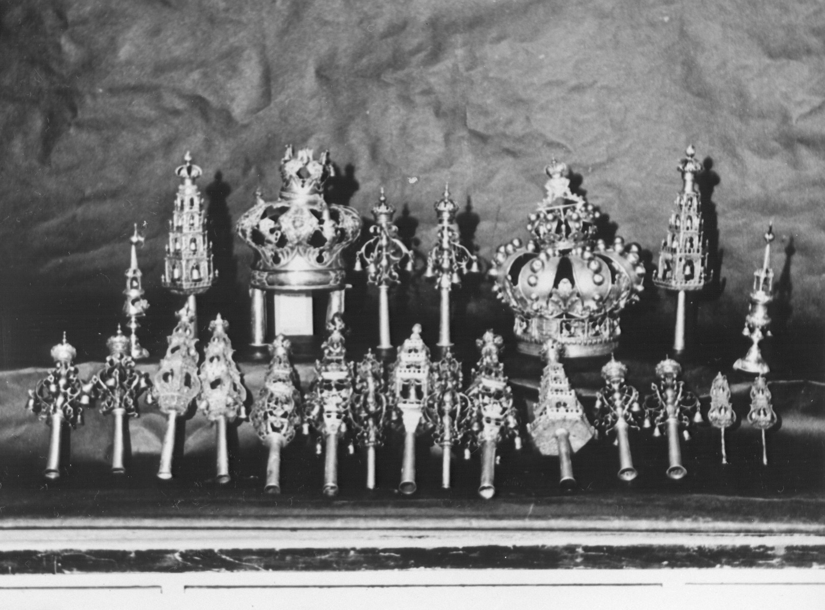 Display of confiscated silver torah crowns looted from European synagogues.