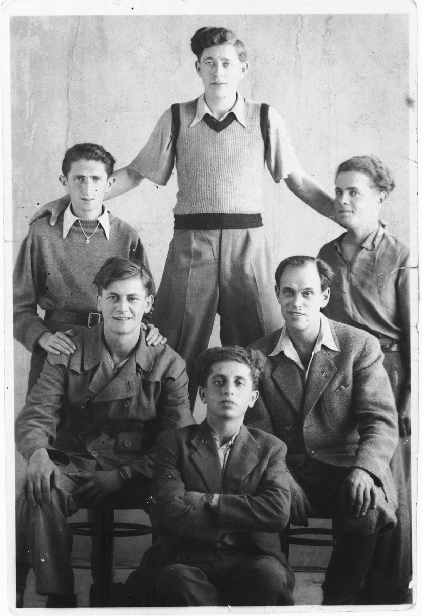 Group portrait of six young Jewish survivors who were recruited by the Bricha in Budapest to serve at the Szengothard crossing on the Hungarian-Austrian border.  Among those pictured is Itzhak Gendelman (top).