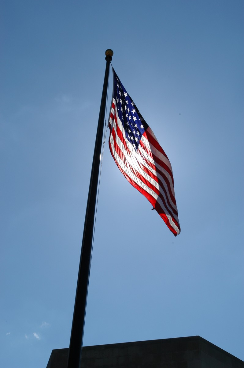 The American flag flies in Eisenhower Plaza at the U.S. Holocaust Memorial Museum.