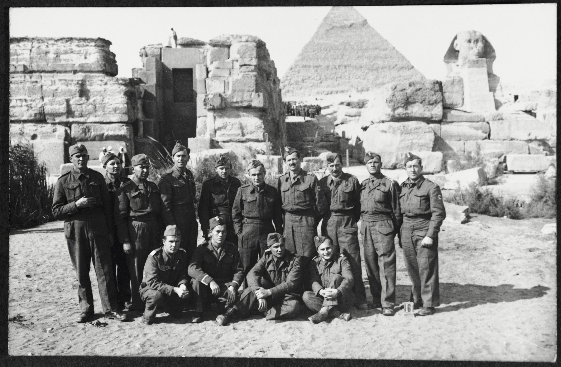 Group portrait of members of the 2nd Polish Corps (Anders Army) during an excursion to the Sphinx in the Giza plateau near Cairo, Egypt, where they were stationed in the winter of 1944.  Among those pictured are Markus Rosenzweig (standing fourth from the left), Jan Wysoki (sitting on the far right), and his friend  Bolek Stankiewicz (standing second from right).