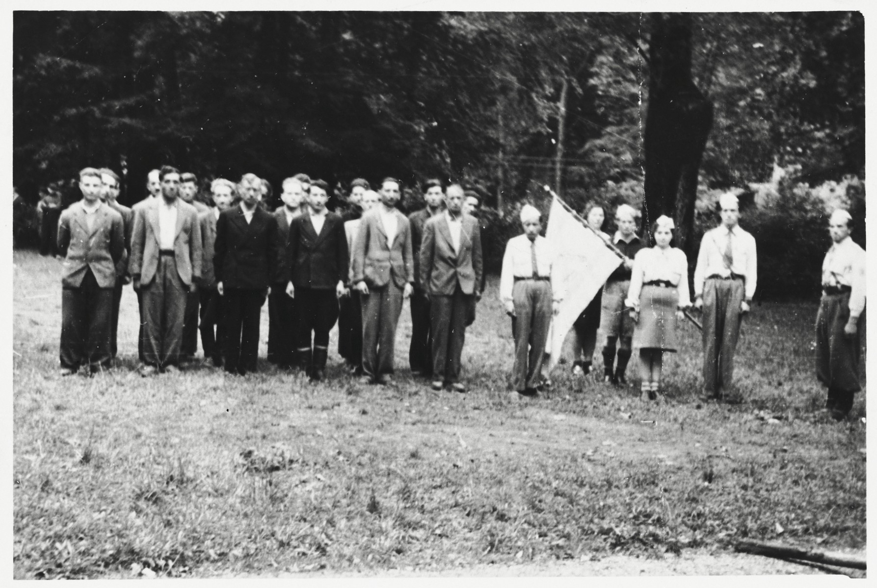 Members of the Betar revisionist Zionist youth movement in the Braunau displaced persons camp stand outside in formation.