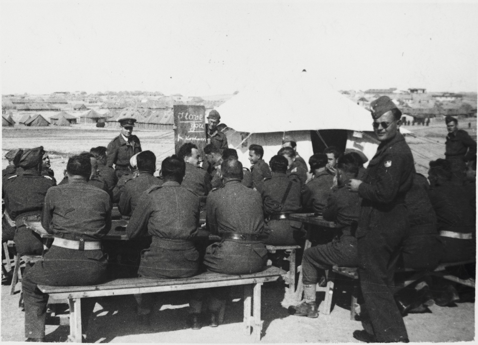 Members of the 2nd Polish Corps (Anders Army) attend an outdoor class at their military base in the Iraqi desert, where they were stationed from the summer of 1942 until the summer of 1943.