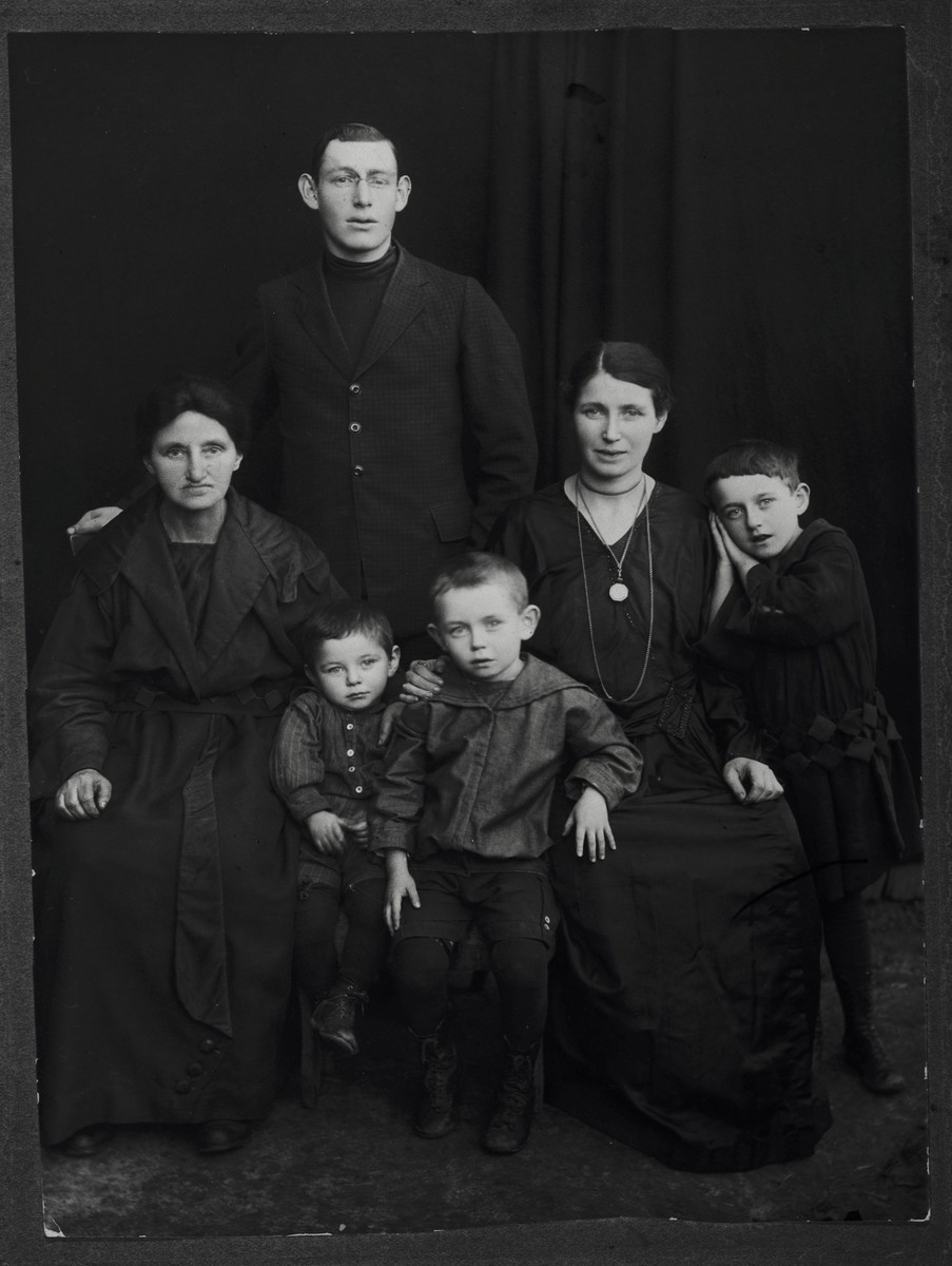 Studio portrait the Pick/Gendelman family in Rokitno, Poland.  Pictured clockwise from the far left are: Esther Malka Pick (mother of Chantzia), Itzik Pick (brother of Chantzia), Chantzia (Pick) Gendelman, Thema Gendelman, Herschel Gendelman and Moniek Gendelman.