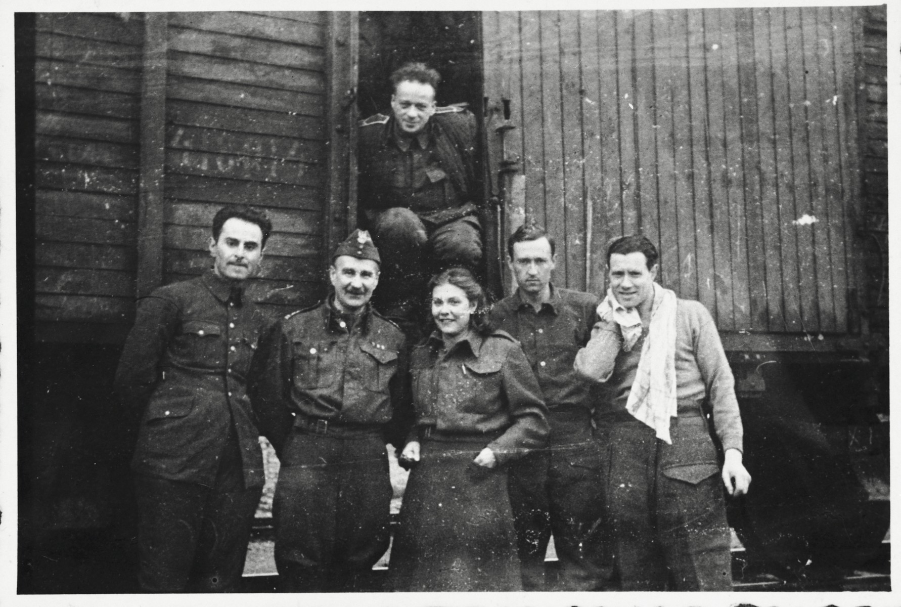 Six members of the Anders Army pose in front of a railcar prior to their departure for Iran.  Pictured at the far left is Markus Rosenzweig.