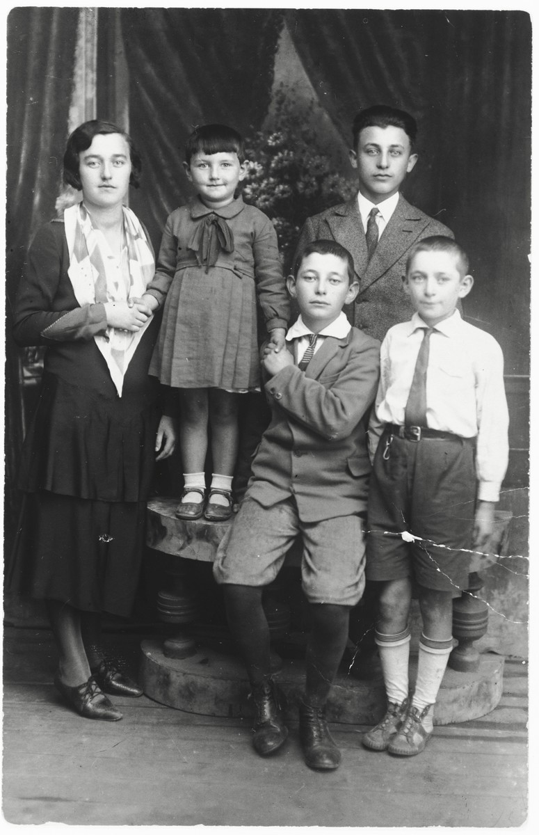 Studio portrait the Pick/Gendelman family in Rokitno, Poland.  Pictured clockwise from the far left are: Thema (Gendelman) Balagole, her daughter Rivka, a Pick cousin, Itzhak Gendelman and Moniek Gendelman (front row, center).  Thema's family all perished during the war.