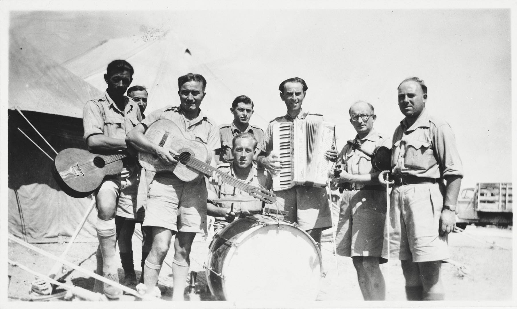 Group portrait of members of the 2nd Polish Corps (Anders Army) band while they were stationed in Palestine.  Markus Rosenzweig is pictured playing the accordian.