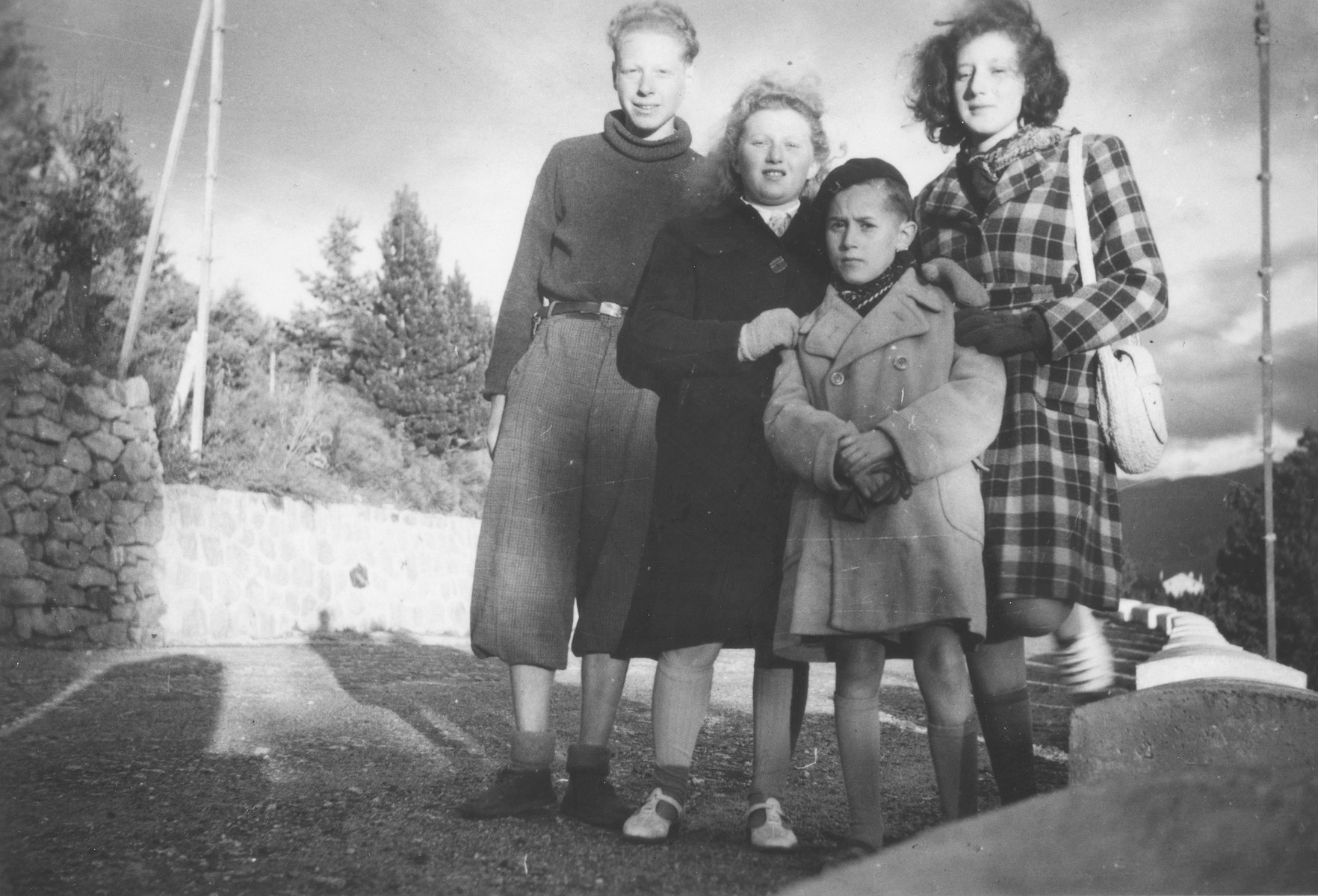 Carl Roman (left) poses with three other children in Font-Romeu, a summer camp site, where they were brought by the OSE after being smuggled out of the Rivesaltes internment camp.