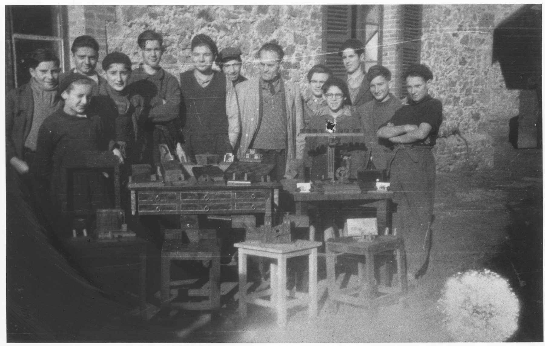 Group portrait of Jewish boys in the carpentry workshop of the Montintin children's home.
