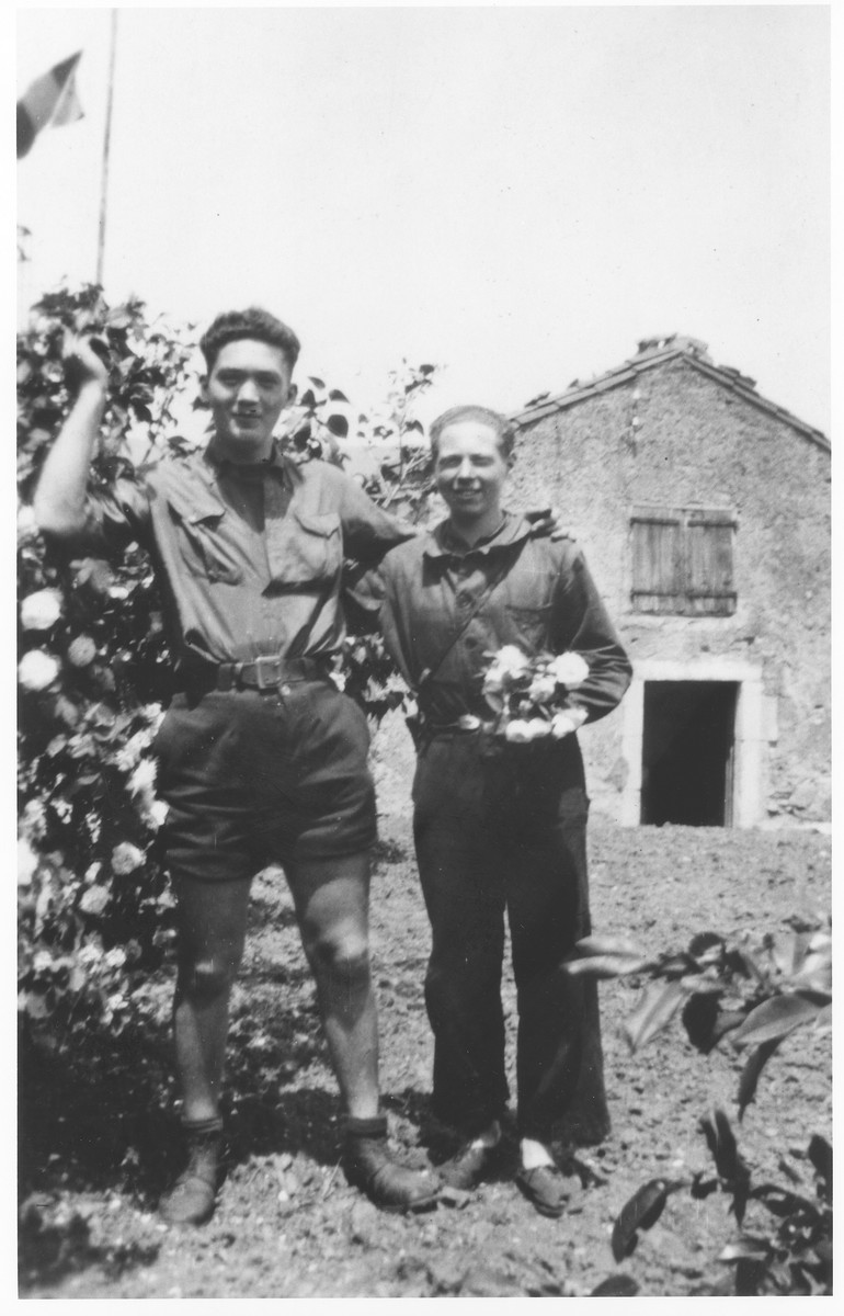 Carl Roman (right) poses in uniform with the one other Jew who was living in hiding in the Compagnons de France Vichy youth camp in Agde.  The other youth, who went by the assumed name of Baner, had been in the Montintin children's home with Carl Roman.  The two boys never spoke to one another while in the camp, but met outside on Sundays.