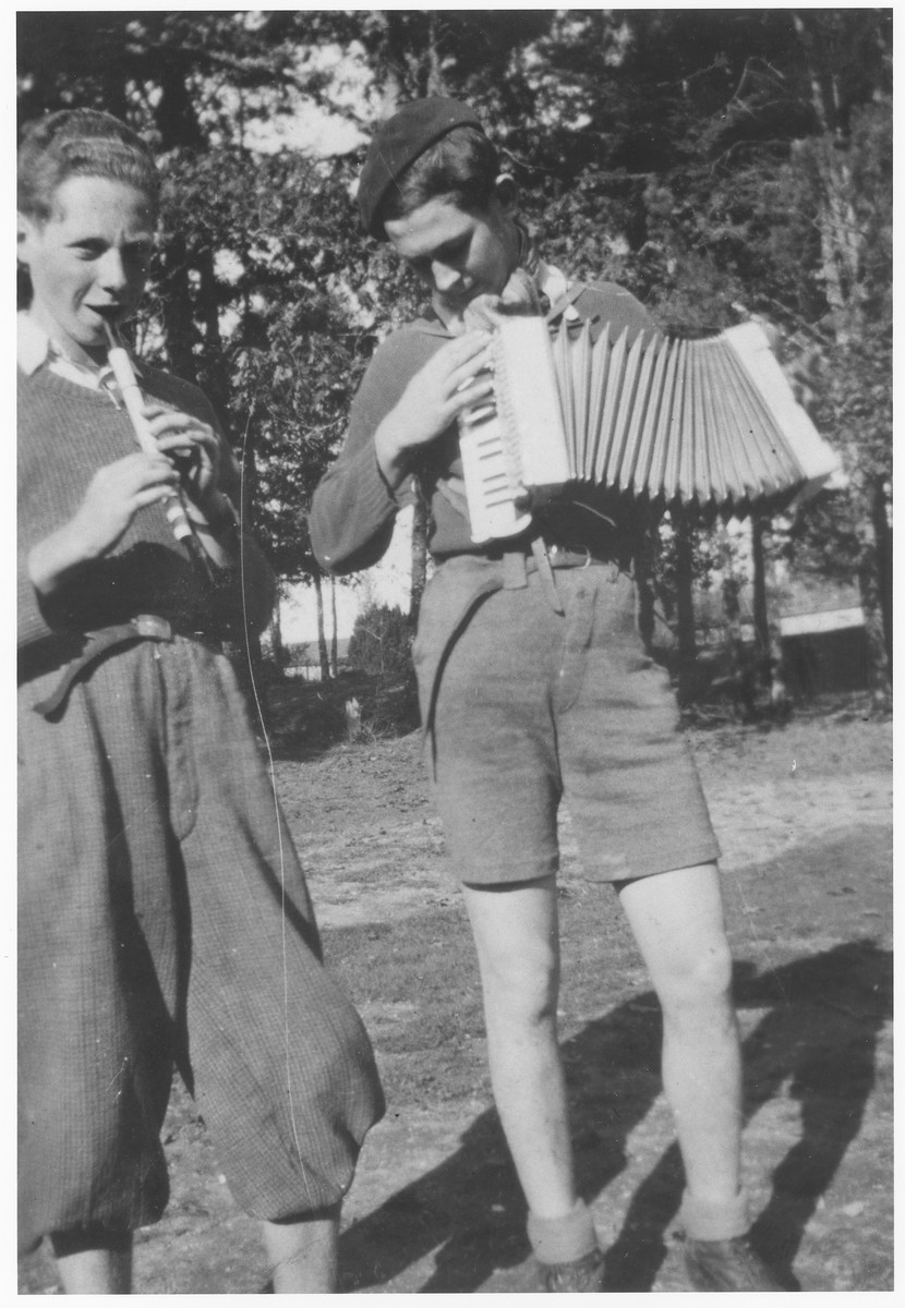 Charles Roman (left) and Herbert Stubnitzer (right) play music together in the yard of the Montintin children's home.