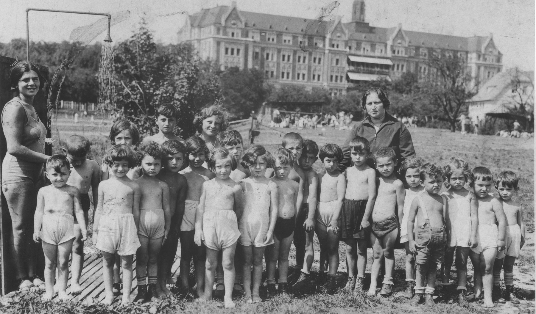 Group portrait of children in a summer camp on the outskirts of Vienna.  Carl Roman is pictured in the first row, center, eighth from the left.