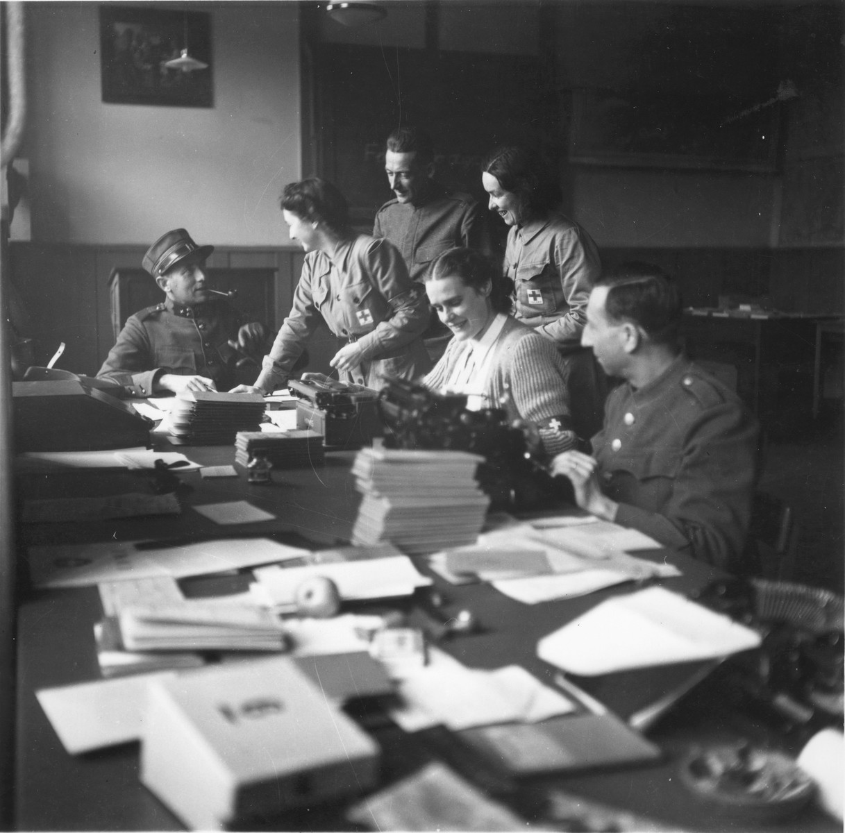 Swiss Red Cross workers and military reservists organize the documentation for Jews rescued from Theresienstadt.
