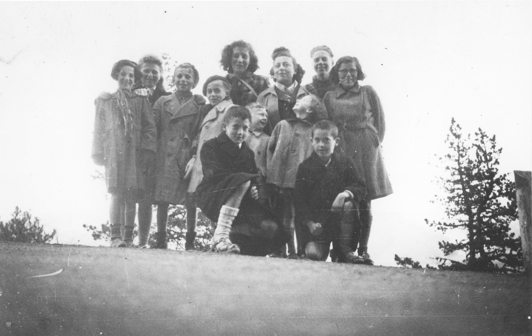 OSE workers pose with a group of children in Font-Romeu, a summer camp site, where they were brought after being smuggled out of the Rivesaltes internment camp.