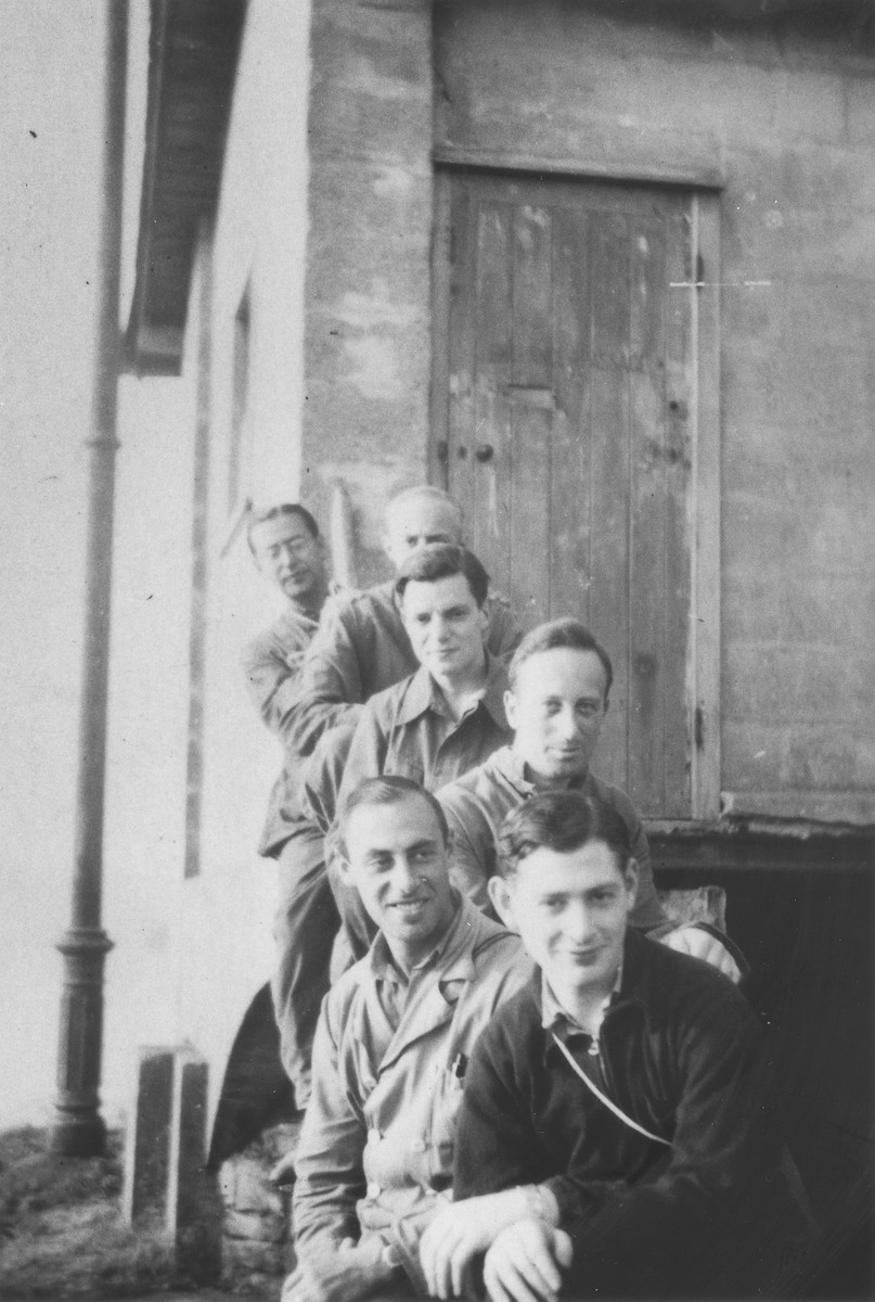 Jewish refugees from Germany and Austria pose on the stoop of a barracks in the Kitchener refugee camp in Richborough (Kent), England.  Those pictured include Herbert Mosheim and Werner Gamby.