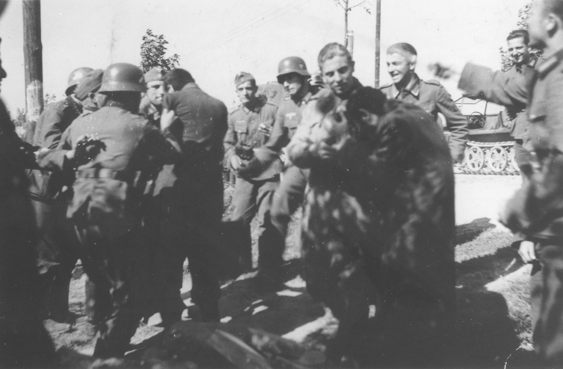 German soldiers beat Polish Jews in the vicinity of Lodz during the invasion of Poland.