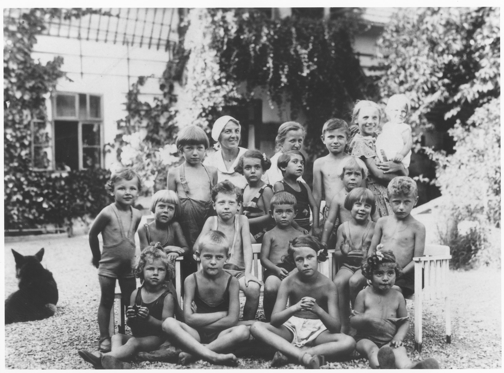 Group portrait of children in a summer camp on the outskirts of Vienna.  Carl Roman is seated in the second row, third from the left.