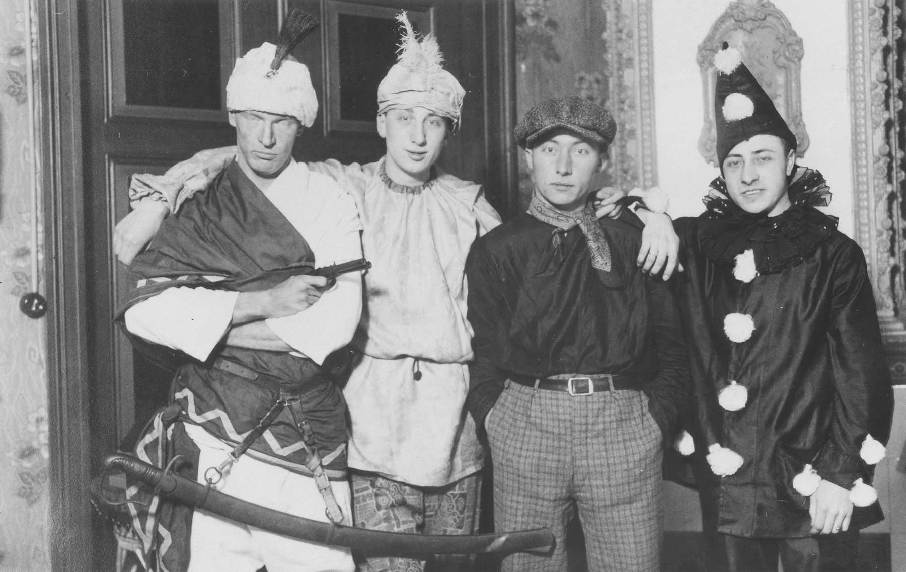 Herbert Mosheim (second from the left) poses in costume with a group of friends during a Fasching celebration.