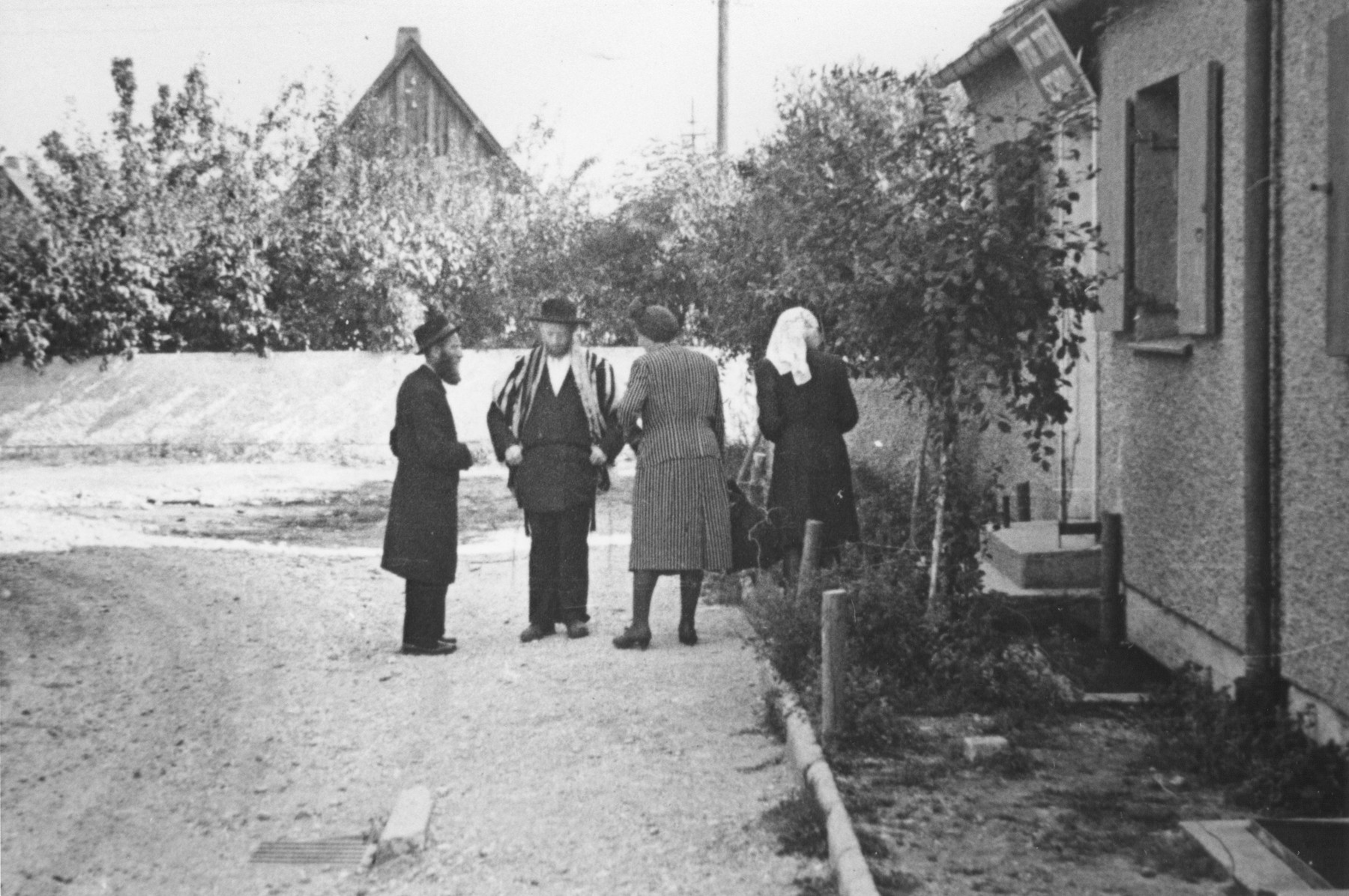 Religious Jews meet outside the synagogue in the Neu Freimann displaced persons camp.
