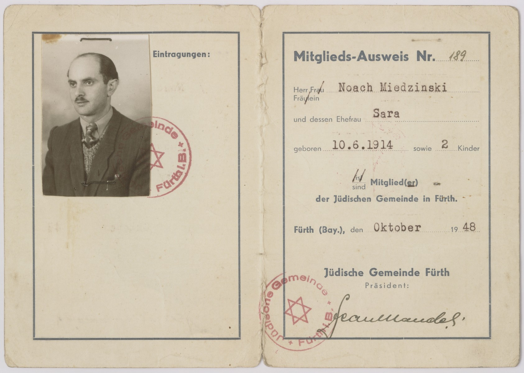 Membership card in the Jewish community in Fuerth issued to Noach Miedzinski, his wife and two children.