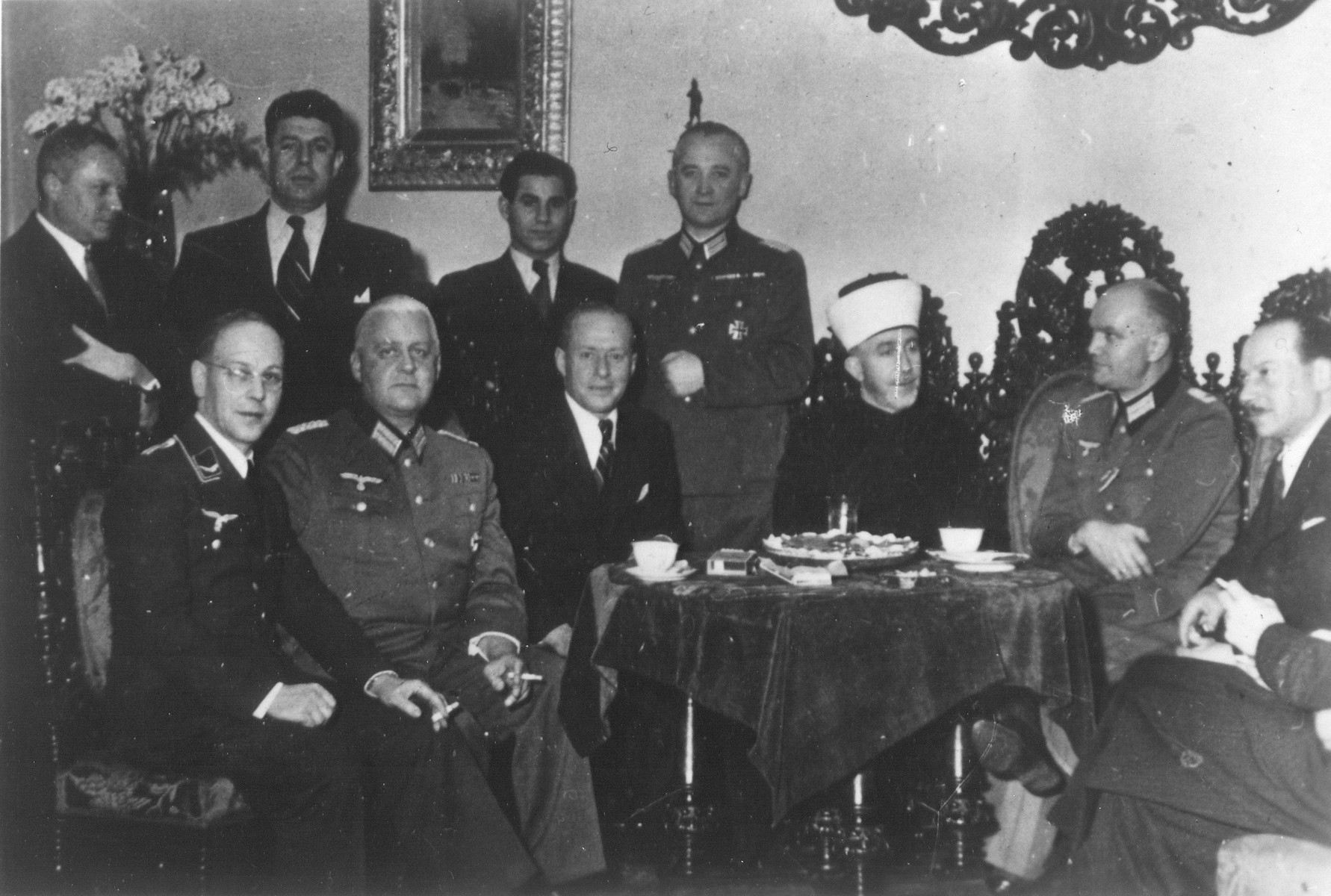 Former Mufti of Jerusalem Hajj Amin al-Husayni poses with Nazi officials at a reception in Berlin.