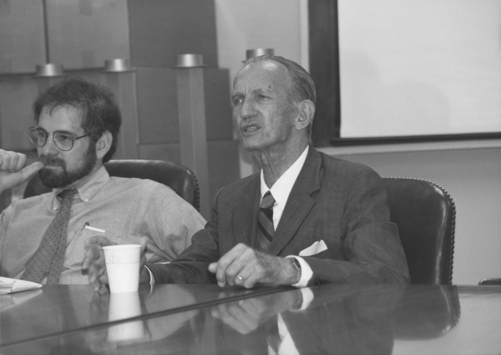 Polish underground courier Jan Karski (right) gives a guest lecture at a U.S. Holocaust Memorial Museum staff seminar on the history of the Holocaust,  Seated next to Karski is Museum Program Director Michael Berenbaum.