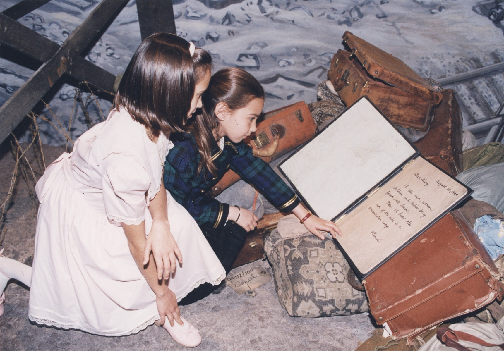 "At the opening of the ""Remember the Children: Daniel's Story"" special exhibition at the U.S. Holocaust Memorial Museum, two young visitors pause to read Daniel's diary, which tells of his family's deportation to Auschwitz."