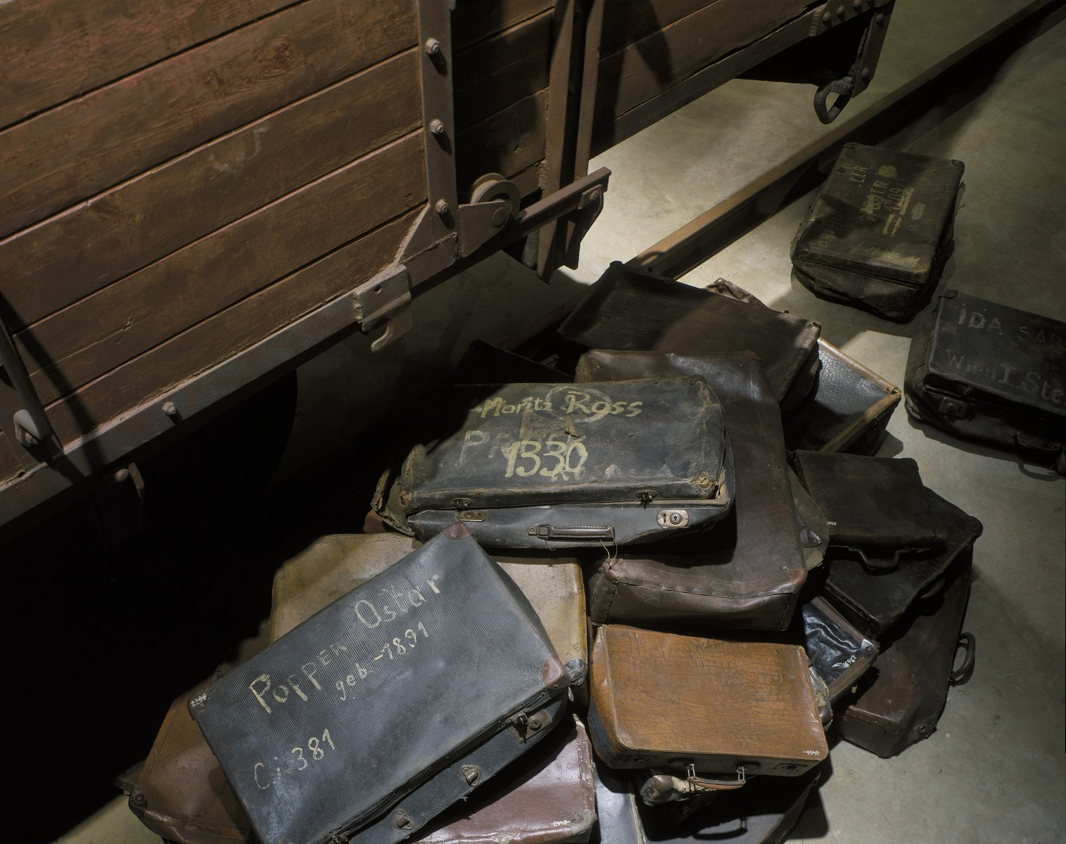 A collection of valises belonging to Jews who were deported to death camps, that are displayed at the base of the railcar on the third floor of the permanent exhibition at the U.S. Holocaust Memorial Museum.