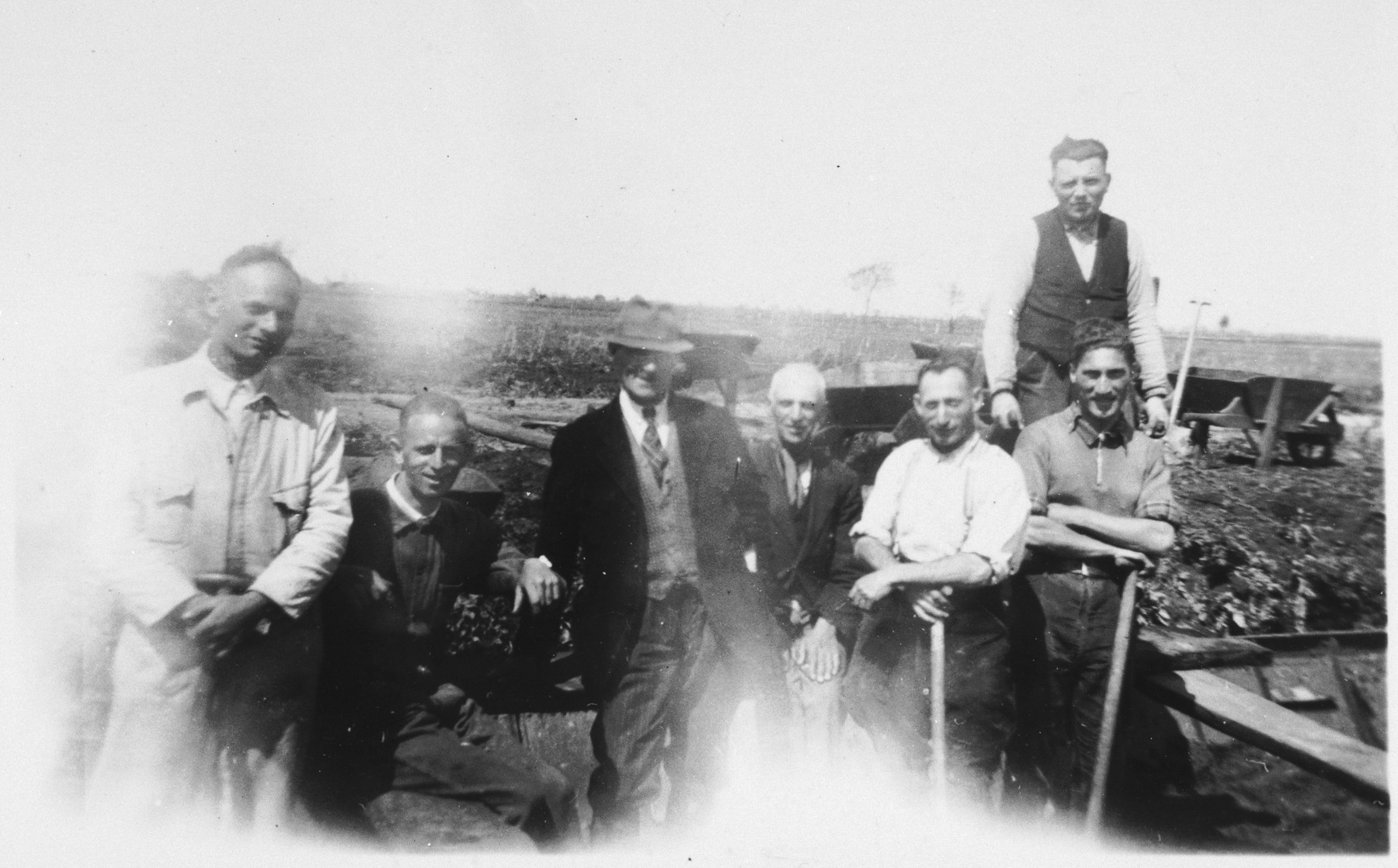 Prisoners are forced to dig a canal in the Staphorst-Rouveen labor camp.  Pictured from left to right are Goedhart, Cardozo, Viterwyk, Vischraper, Cohen, Jas, and Coenraad Rood.