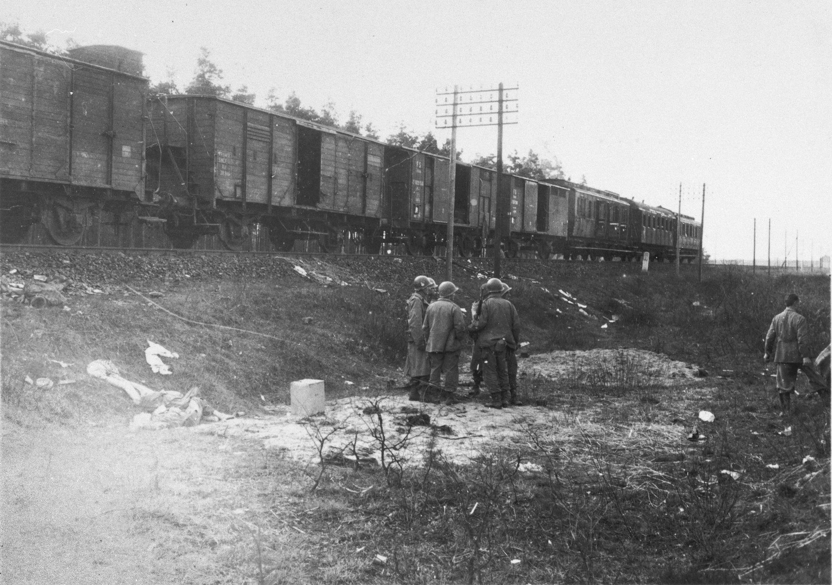General Wyman and other American soldiers inspect a death train in Schwandorf, Germany.