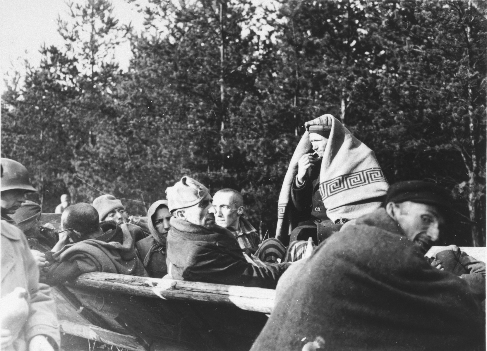 Survivors of the Schwandorf death train are evacuated by wagon.