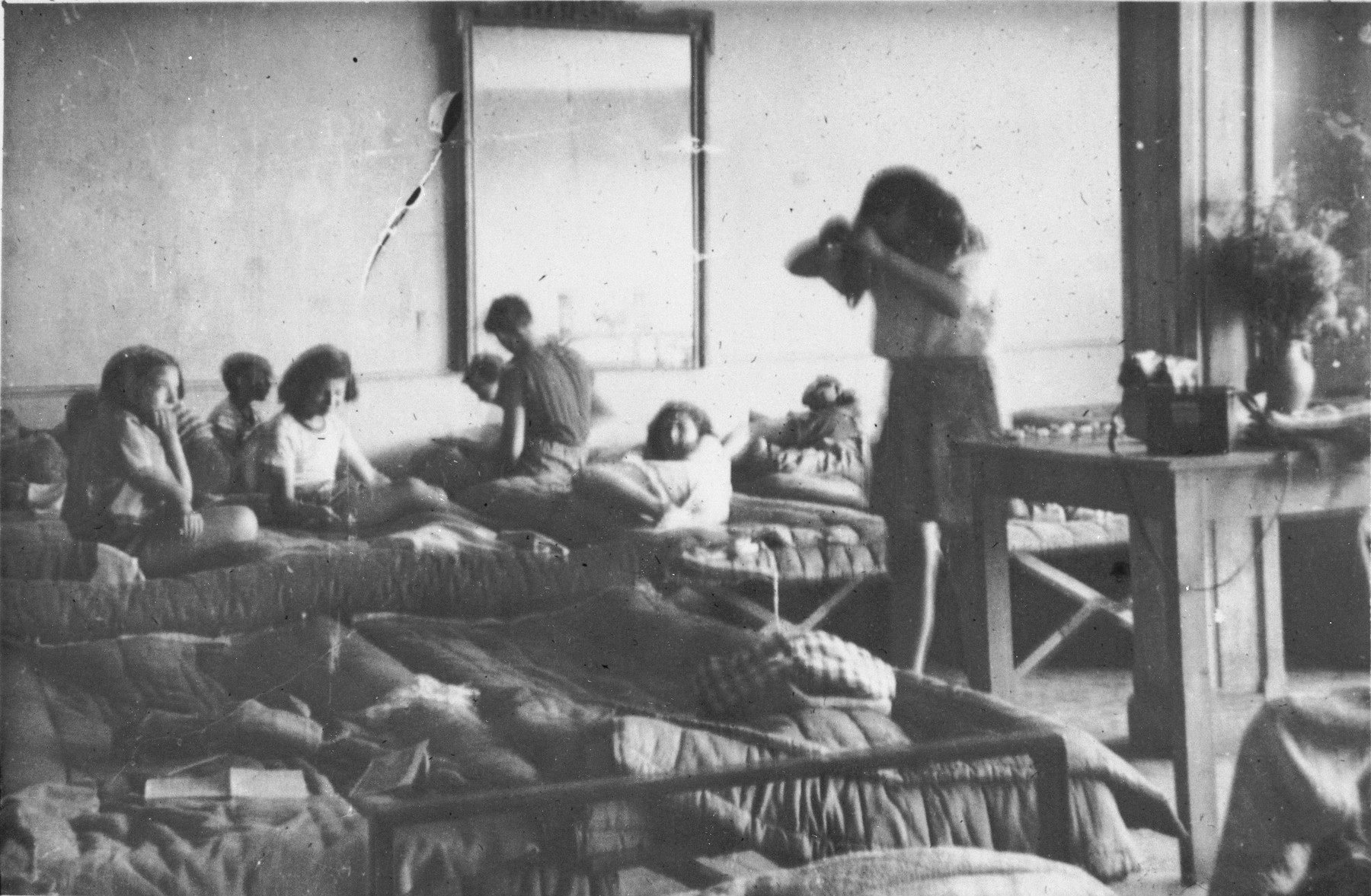 Girls living in a dormitory at the Mehoncourt children's home get up in the morning.